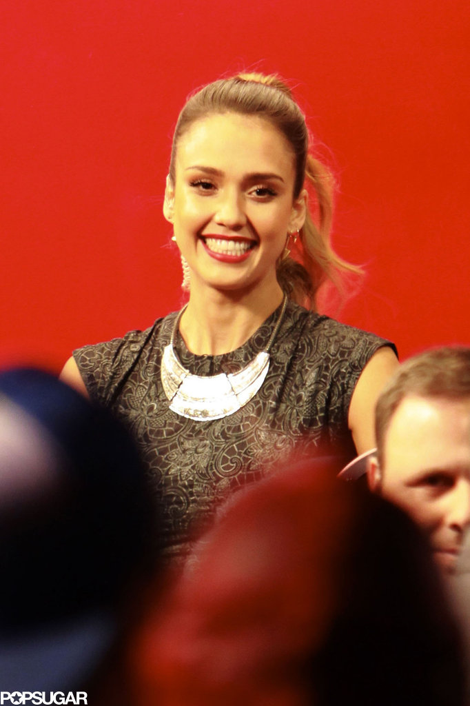 """Jessica Alba smiled at her fans waiting to get """"kisses"""" from her."""