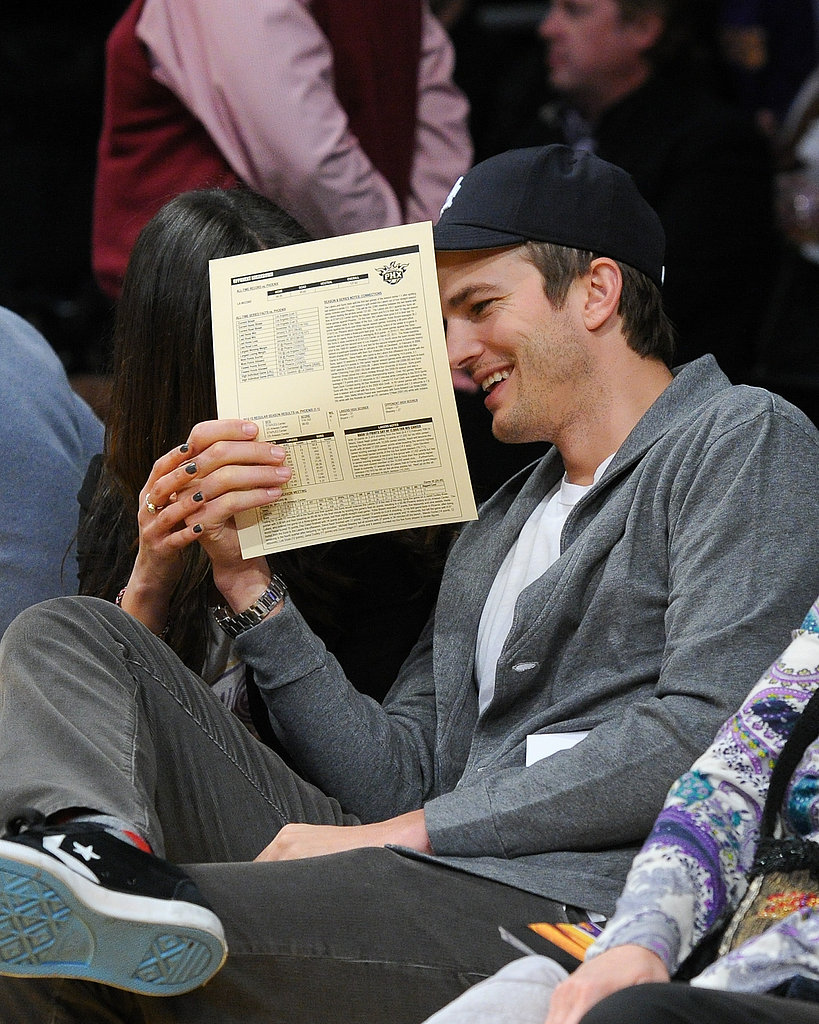 Ashton Kutcher smiled while out with girlfriend Mila Kunis in LA.