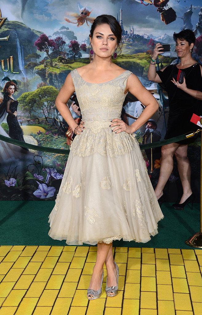 Mila Kunis hit the red carpet in a Dolce & Gabbana dress at the LA premiere of Oz the Great and Powerful.