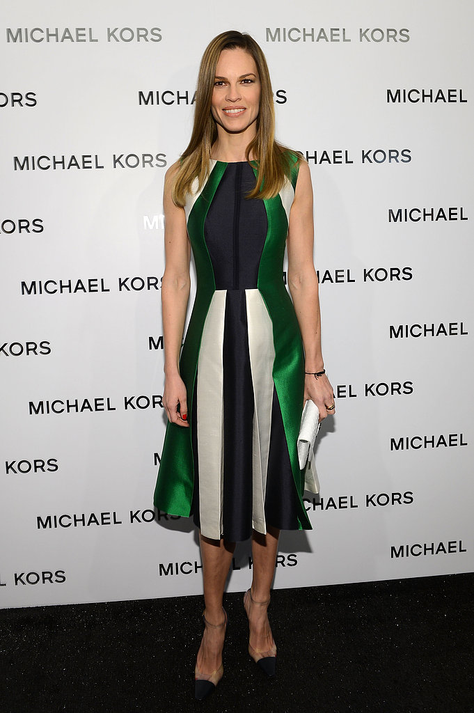 Hilary Swank showed her support for Michael Kors in a colorblock A-line dress, a white leather clutch, and translucent cap-toe pumps at the designer's Fall 2013 show.