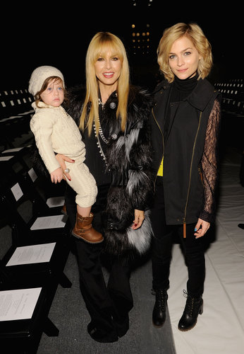 Rachel Zoe and Leigh Lezark donned two different, but equally stunning coats, at Rachel's Fall 2013 show. Although Rachel definitely has the cutest accessory, baby Skyler.