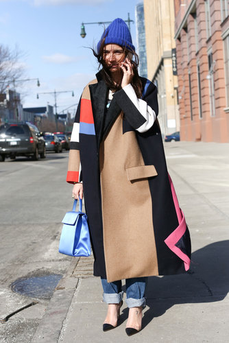 A bold statement coat and transparent captoes gave her jeans a high-fashion tilt.