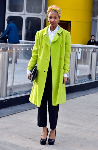 High-wattage outerwear and a multicolored turban lent statement power to a collared button-up and black trousers.