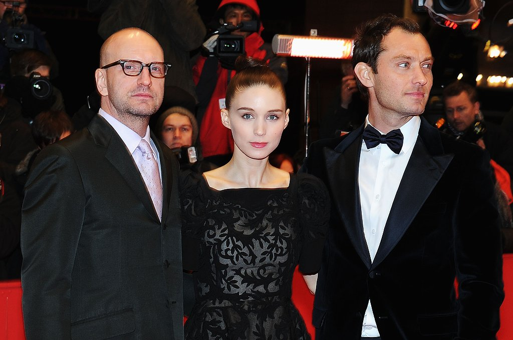 Rooney Mara stood in between Side Effects director Steven Soderbergh and co-star Jude Law at the red carept premiere.