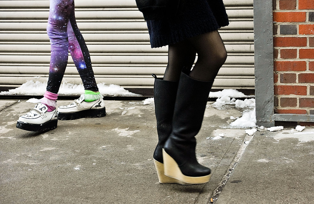 This showgoer was styled — and ready for the snow — in wedged knee-high boots.