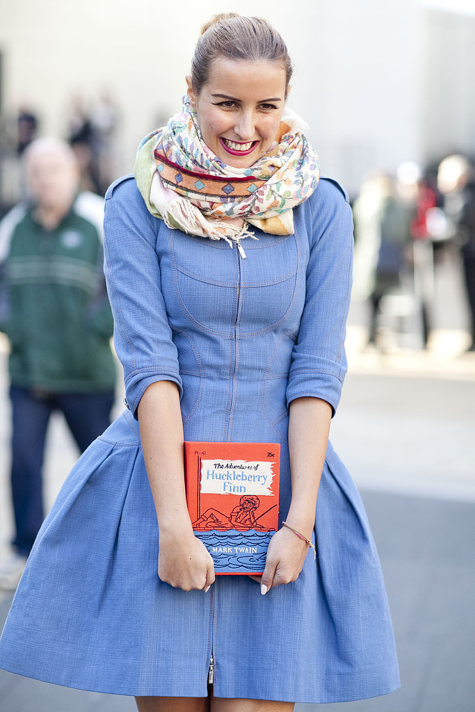 We love the sweet shape of her dress, not to mention her adorable literary clutch.