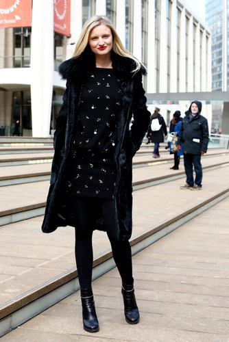 The all-over embellishment on this jet-black sheath drew us to this look outside the tents.