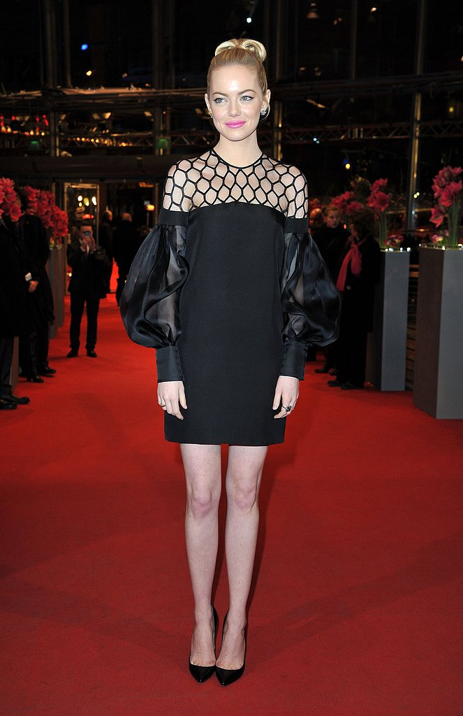 Mod met glam when Emma Stone showcased a little black dress with poufy sleeves and a netted bodice at the Croods premiere at the Berlin Film Festival.