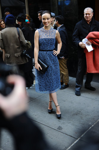 At the show, Olivia Wilde ditched her coat and showed off a delicate sheath.