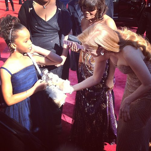 Jessica Chastain admired Quvenzhané Wallis's purse on the red carpet. Source: Instagram user theacademy