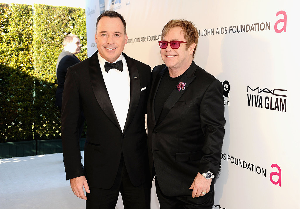 Hosts Elton John and David Furnish smiled at their Oscar party in LA.