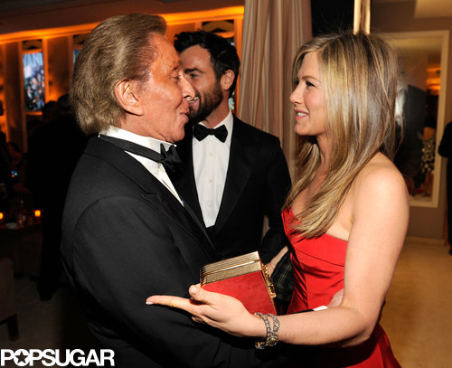 Jennifer Aniston shared a moment with Valentino Garavani at the Vanity Fair Oscar party after Sunday night's award show.