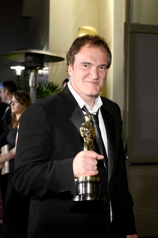 Quentin Tarantino held up his Oscar at the Governors Ball.