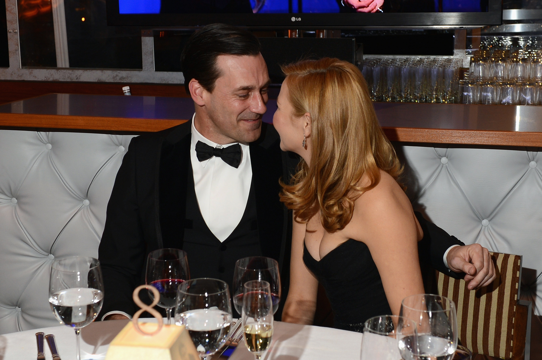 Jon Hamm and Jennifer Westfeldt snuggled in a booth at the Vanity Fair Oscar party on Sunday night.