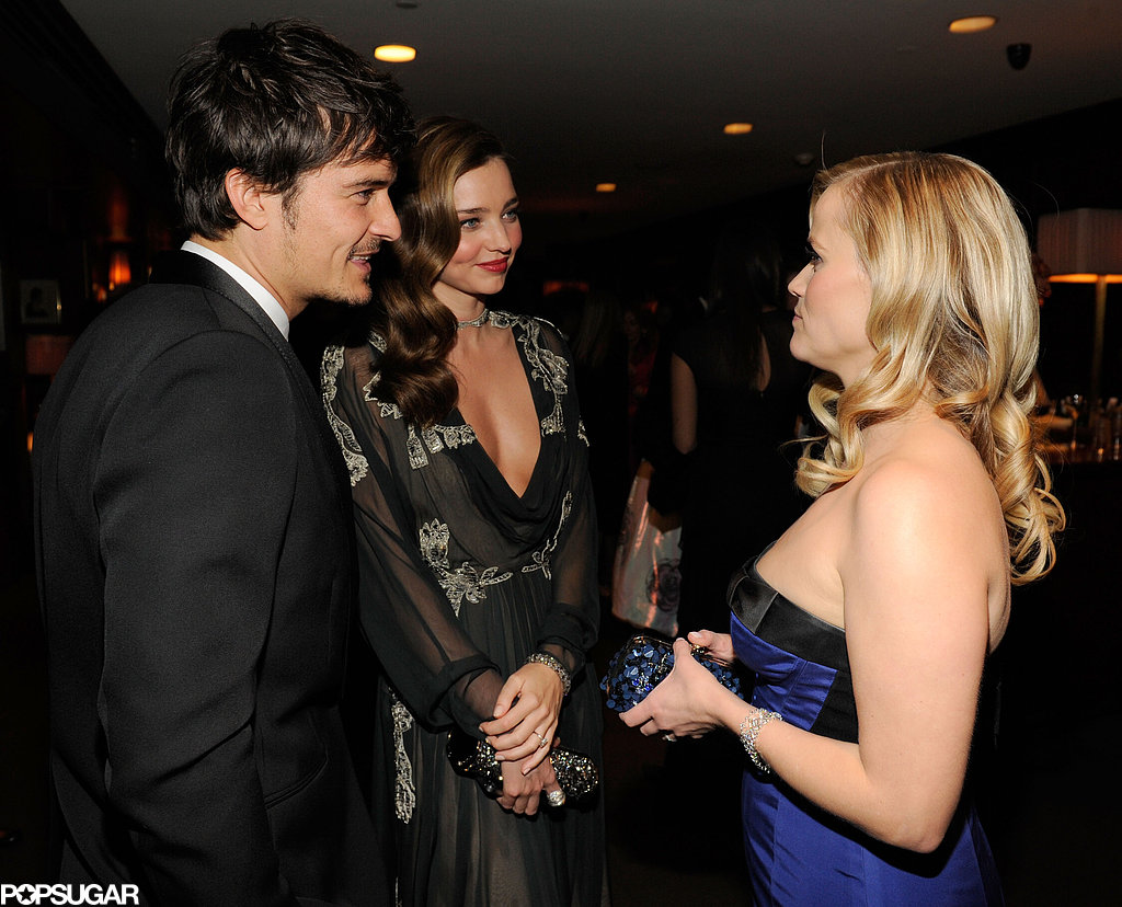Reese Witherspoon chatted inside the Vanity Fair Oscar party with Miranda Kerr and Orlando Bloom.
