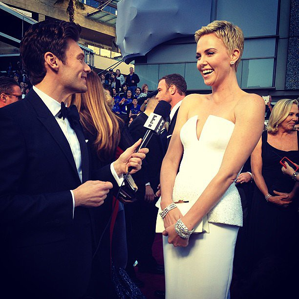 Charlize Theron glowed while talking to Ryan Seacrest on the red carpet at the Oscars. Source: Instagram user ryanseacrest