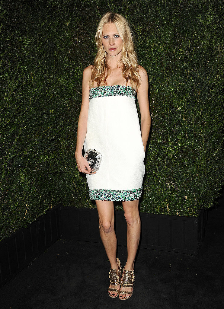 Poppy Delevingne opted for a bit of sparkle by way of a strapless green, navy, and white sequined Chanel Spring '13 dress for the label's fifth annual pre-Oscars dinner.