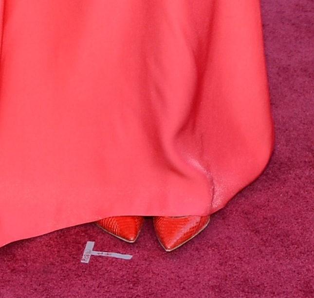 We got just a peek at the red snakeskin Christian Louboutin pumps Kerry Washington sported with her coral Miu Miu gown at the Oscars.