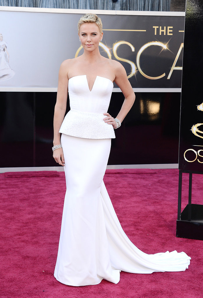 Couture doesn't have to be festooned with floral embroidery or sequins, and Charlize Theron proved that earlier this year when she wore a striking strapless white Christian Dior Couture gown to the Oscars.