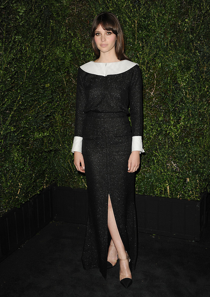 Felicity Jones covered up in a sophisticated black-and-white dress from the Chanel Spring '13 collection for the Chanel dinner. We love the contrast in stark hues, but most of all, we love the sexy front slit.