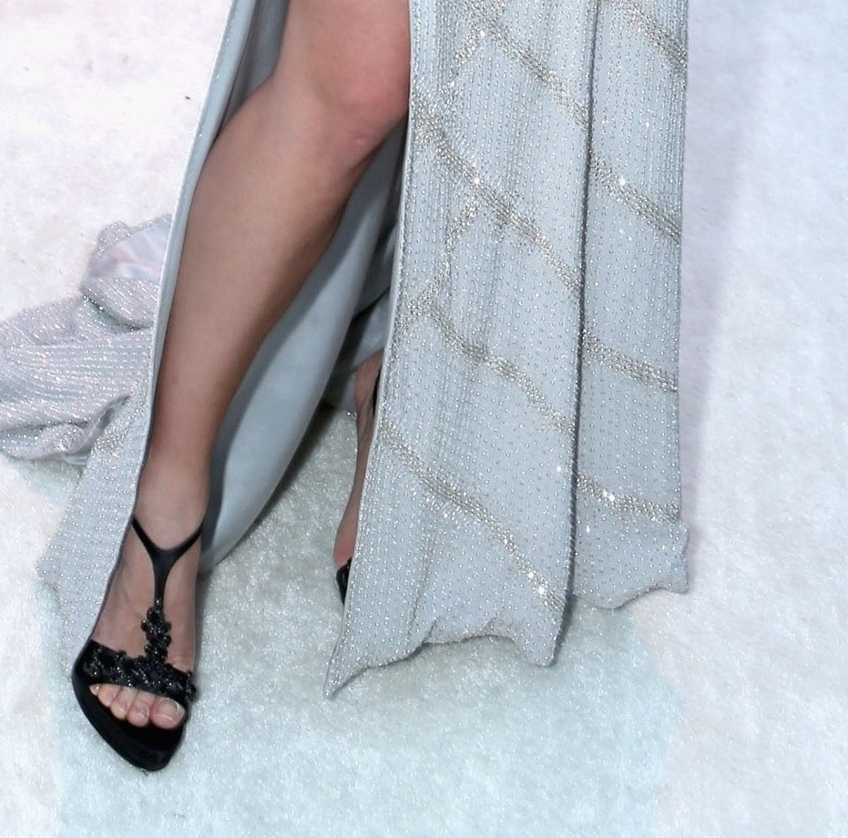 Petra Nemcova's side slit revealed black jewel-embellished T-strap sandals at Elton John's Oscars viewing party.