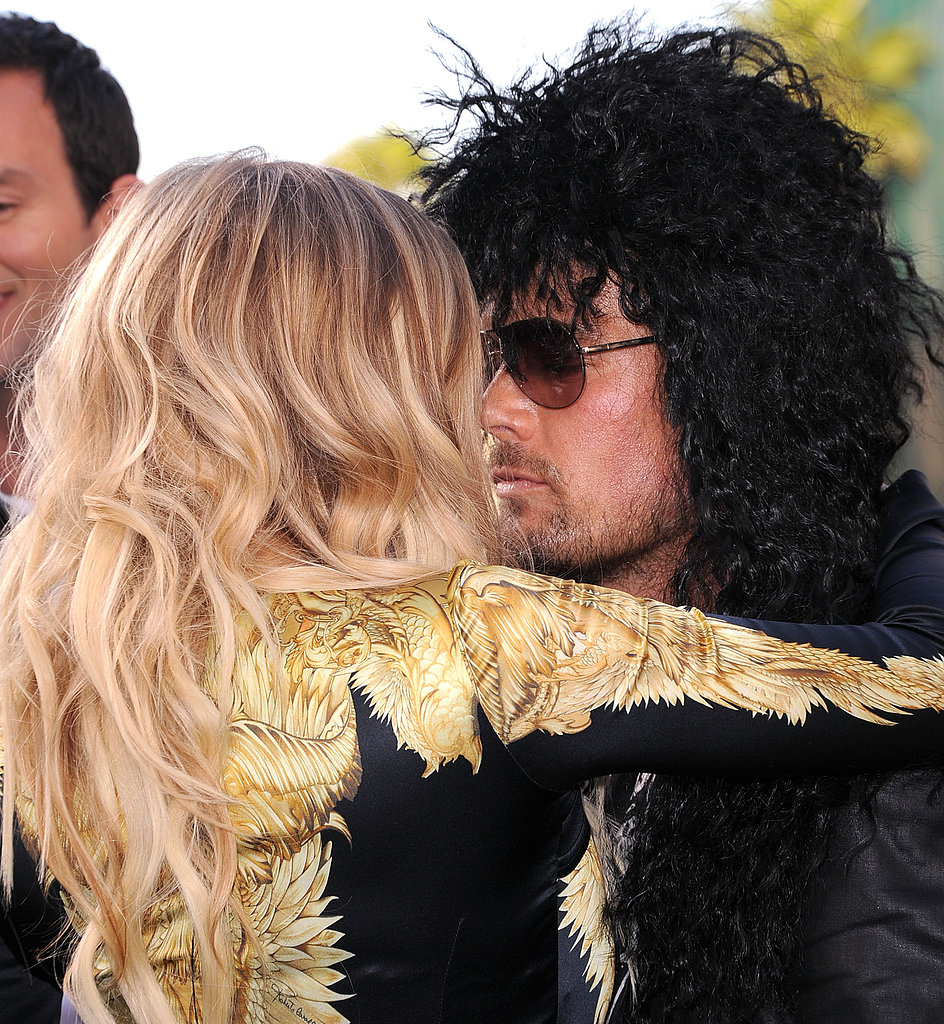 Fergie and husband Josh Duhamel snuggled up at the Rock of Ages LA premiere in June 2012.