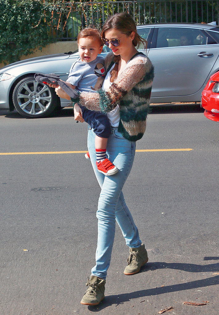 Miranda Kerr crossed a street with Flynn Bloom in her arms.