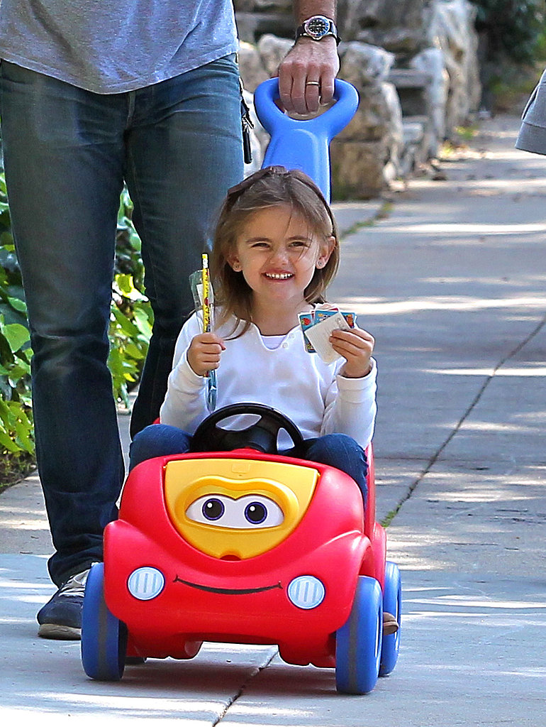 Anja smiled while riding in her toy car in LA on Monday.