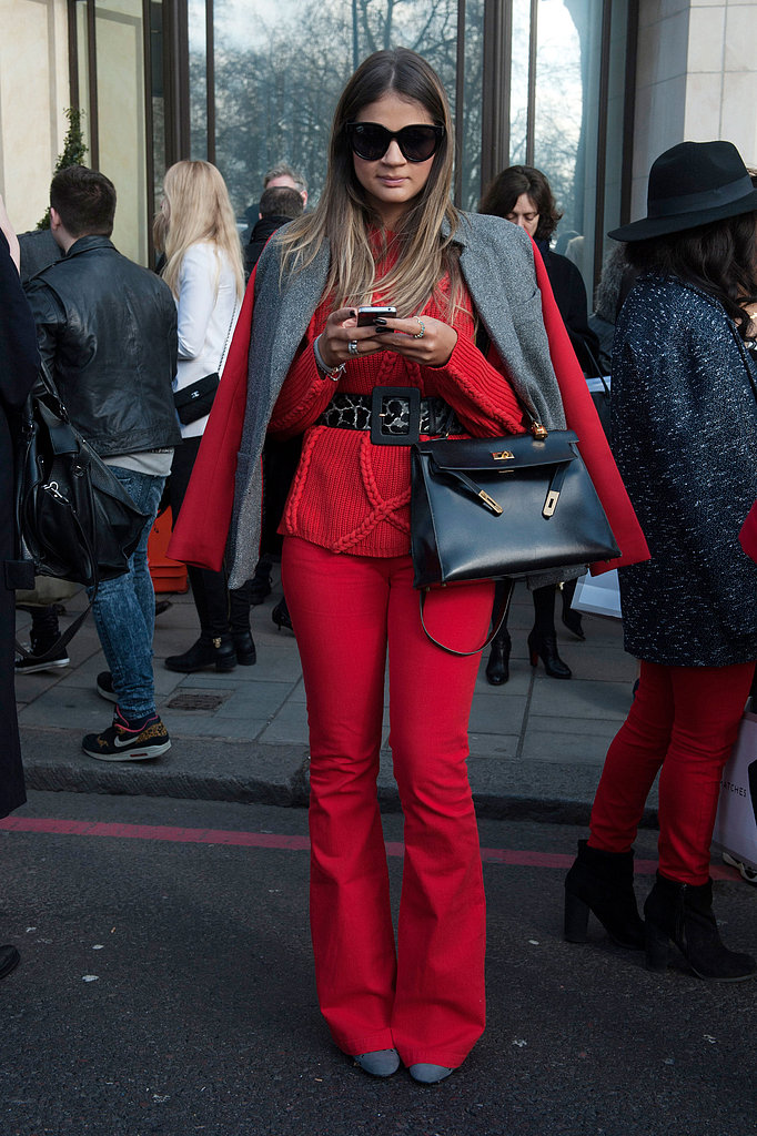 Red on red emboldened this showgoer's separates.