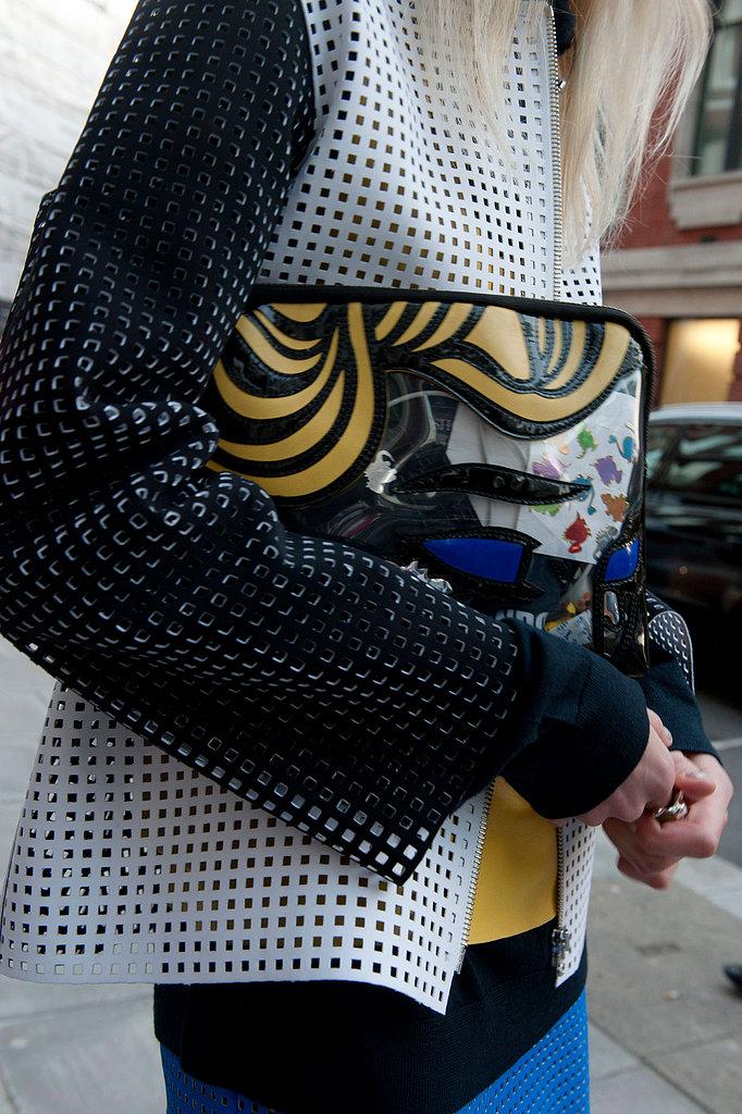 A laser-cut blazer got a dose of whimsy via a 3.1 Phillip Lim comic clutch.