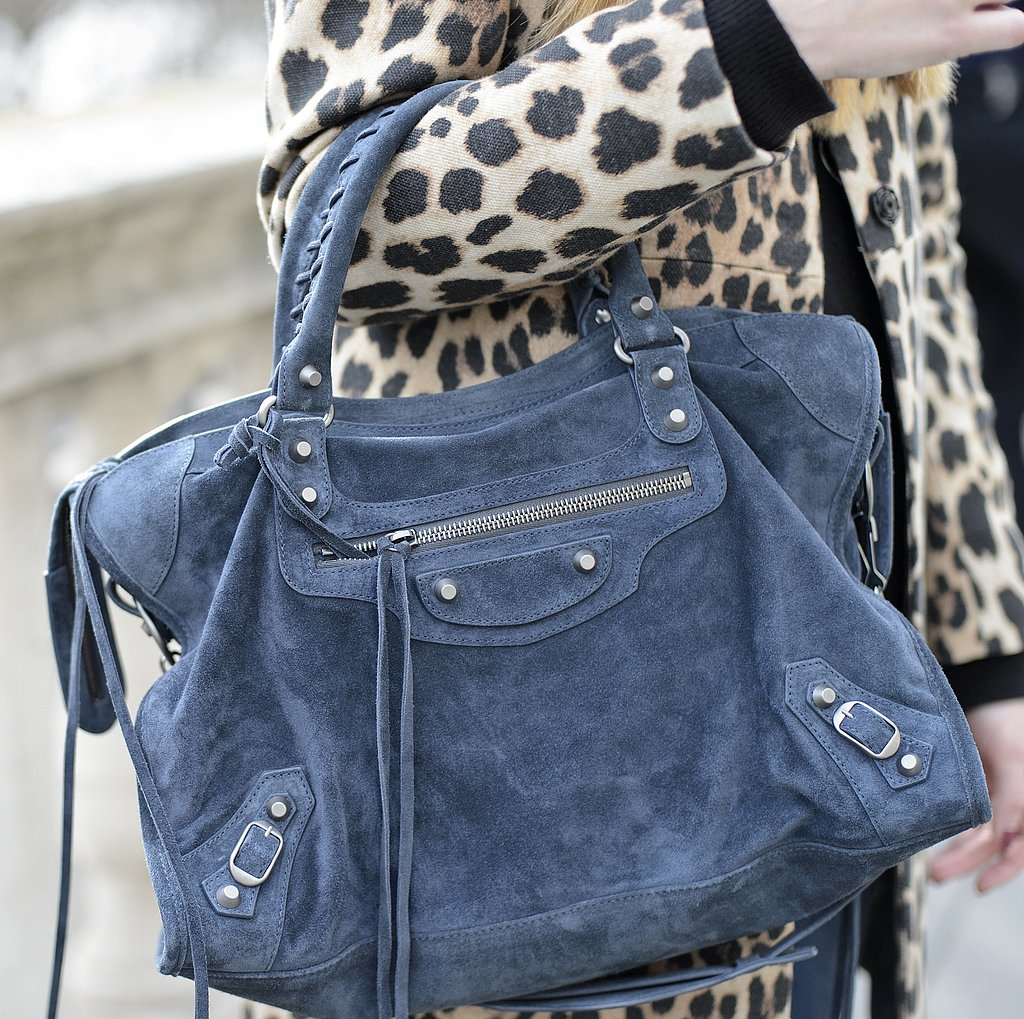 A blue suede Balenciaga bag popped against a leopard coat.
