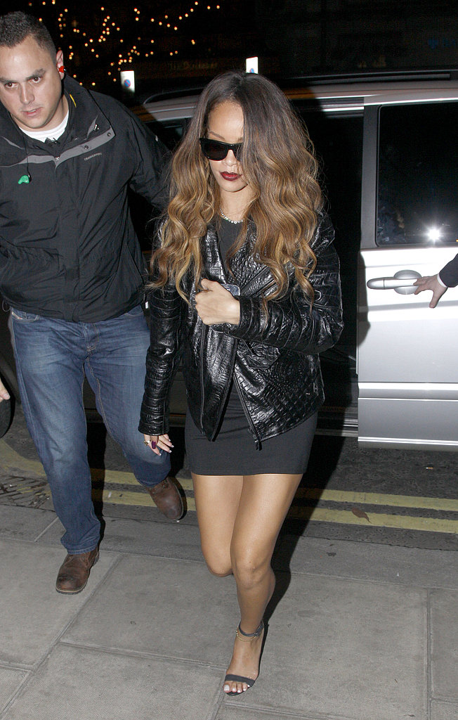Rihanna headed to the after-party for her River Island collection launch looking slick in a little black dress, a crocodile leather jacket, and black-out shades.