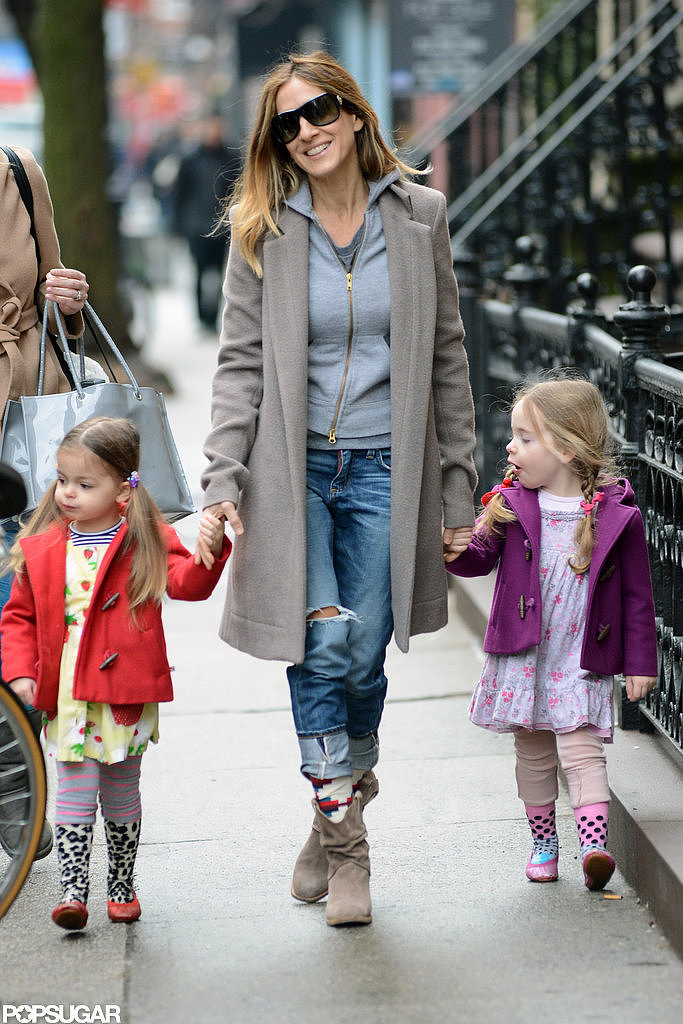 While strolling with their mom last month, Tabitha and Loretta wore coordinating, but not matching, ensembles. The girls looked absolutely adorable in their layered baby-doll dresses, leggings, legwarmers, and ballet flats. Bright duffel coats kept them warm in bold shades of red and purple.