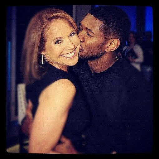 Katie Couric got a sweet smooch on the cheek from Usher. Source: Twitter user katiecouric