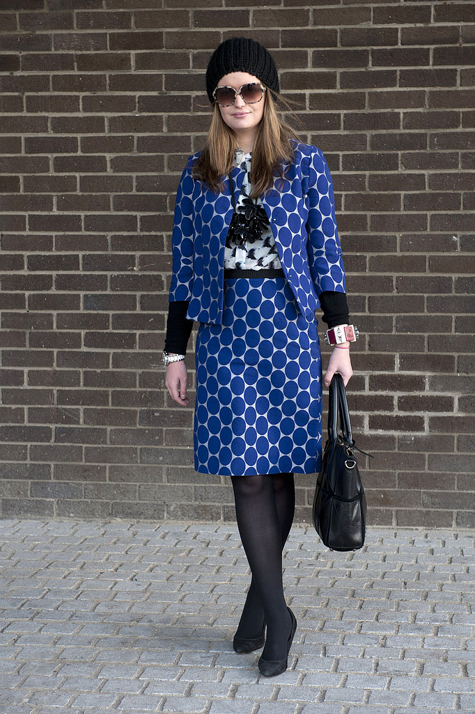 Bold polka dots got this attendee's ladylike suiting noticed outside the shows.