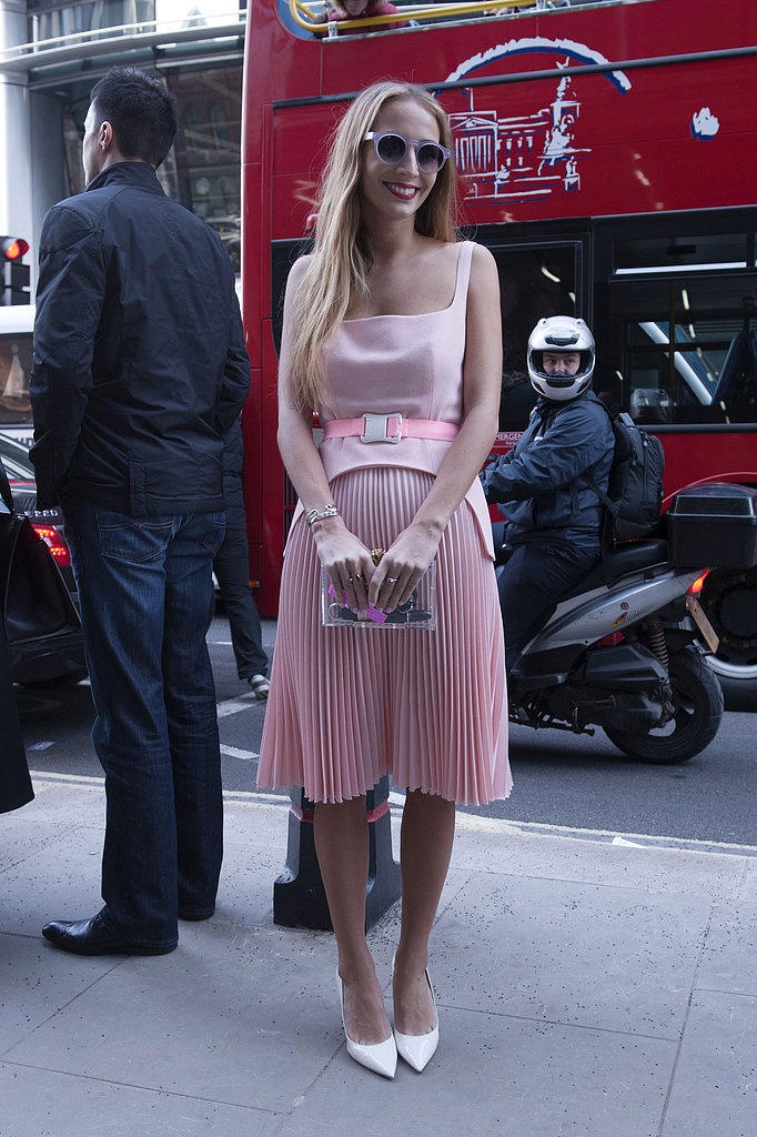 Harley Viera-Newton was all smiles in Christopher Kane's pretty pink pleats outside the shows.