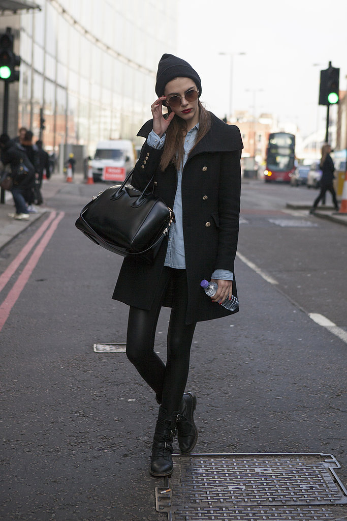 Slick leather and biker boots got a warm Winter complement from this showgoer's military-style coat.