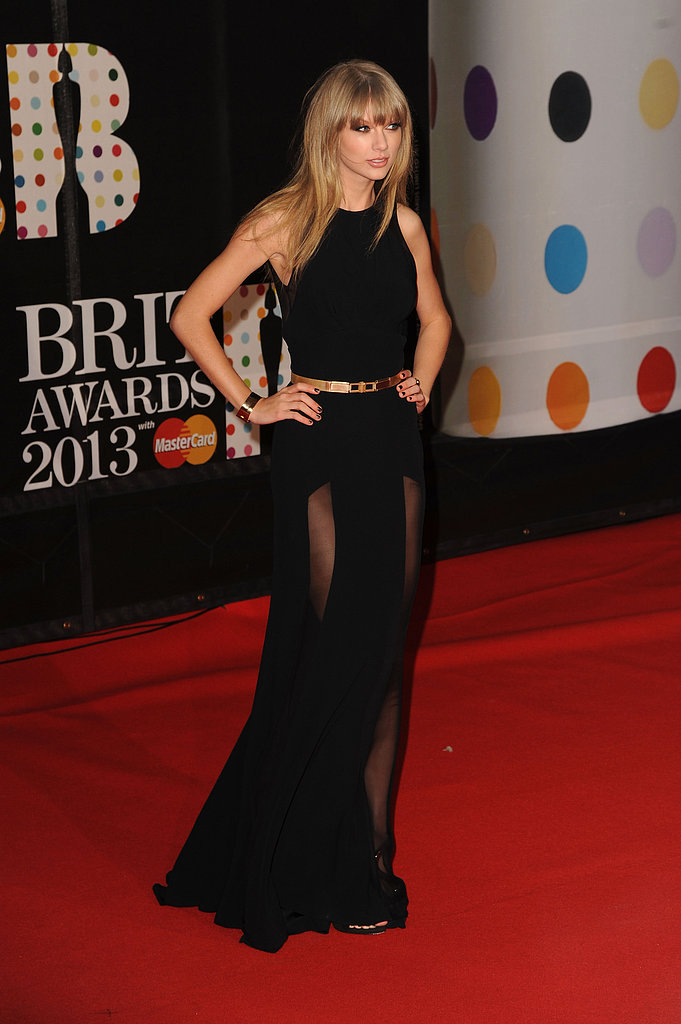 Taylor Swift struck a pose in a sheer black Elie Saab gown at the Brit Awards in London.