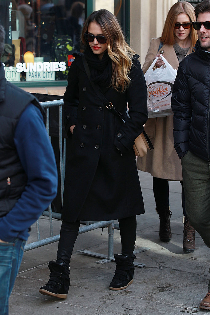 A Sundance Film Festival street look from Jessica Alba: Tory Burch trench coat, coated denim, high-top Isabel Marant sneakers, and a two-toned Marni bag.