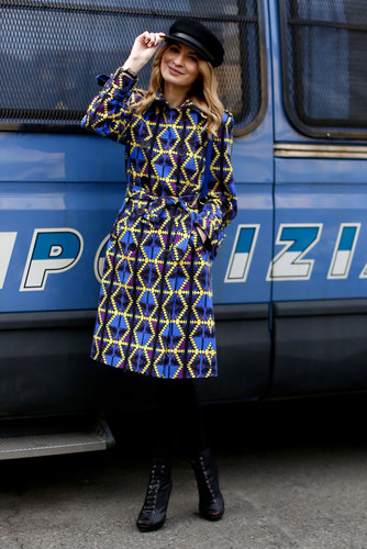 A geometric print emboldened a classic trench coat silhouette — we love the cap for added Fashion Week flair.