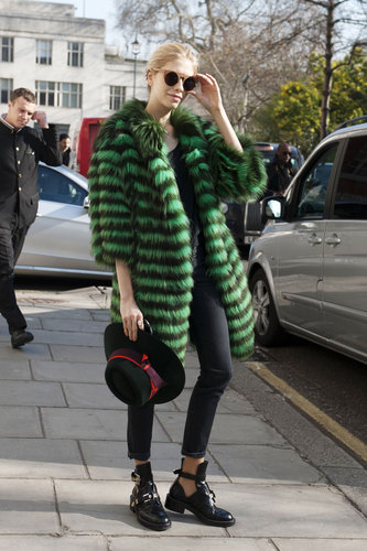 Elena Perminova added a bold green fur to basic black — then finished the look with edgy, cutout boots.