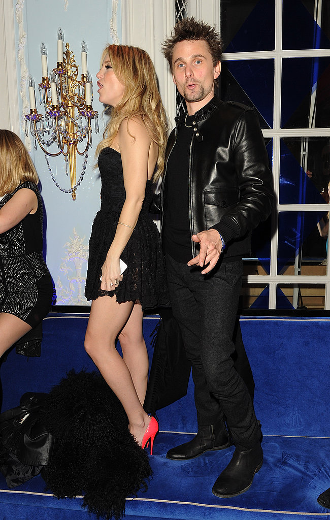 Kate Hudson showed off her legs in an LBD while dancing on a banquette with fiancé Matthew Bellamy at a Brit Awards afterparty in London.