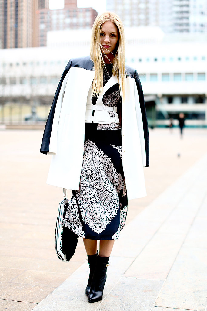For an obvious take on the trend, opt for an all-over black and white dress, like this attendee's BCBG Max Azria sheath — bonus points for a white and black coat or jacket to top it all off.