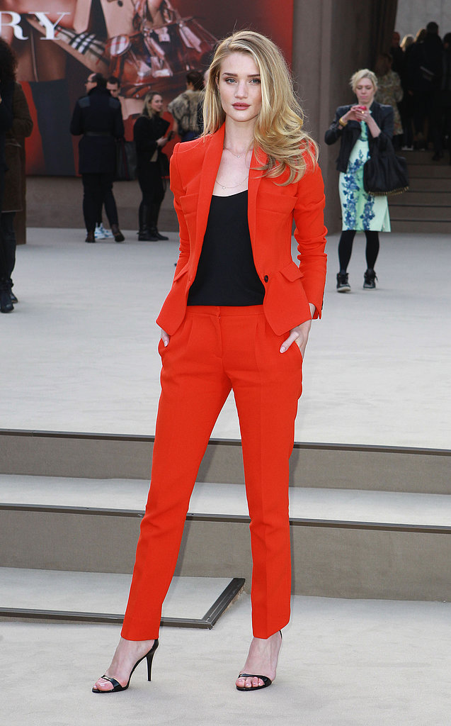 Rosie Huntington-Whiteley stepped out for Burberry's Fall '13 show in London in the chicest kind of suiting — looking runway-ready herself.
