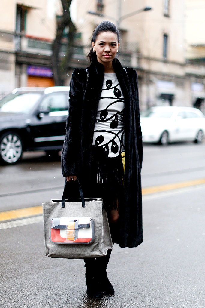 This attendee made a statement in a unique top and bold bag in hand.