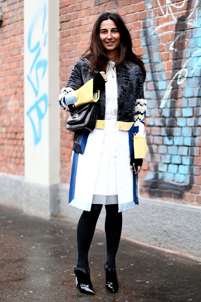 A statement coat and sleek LWD were perfect opposites against black tights and patent booties.