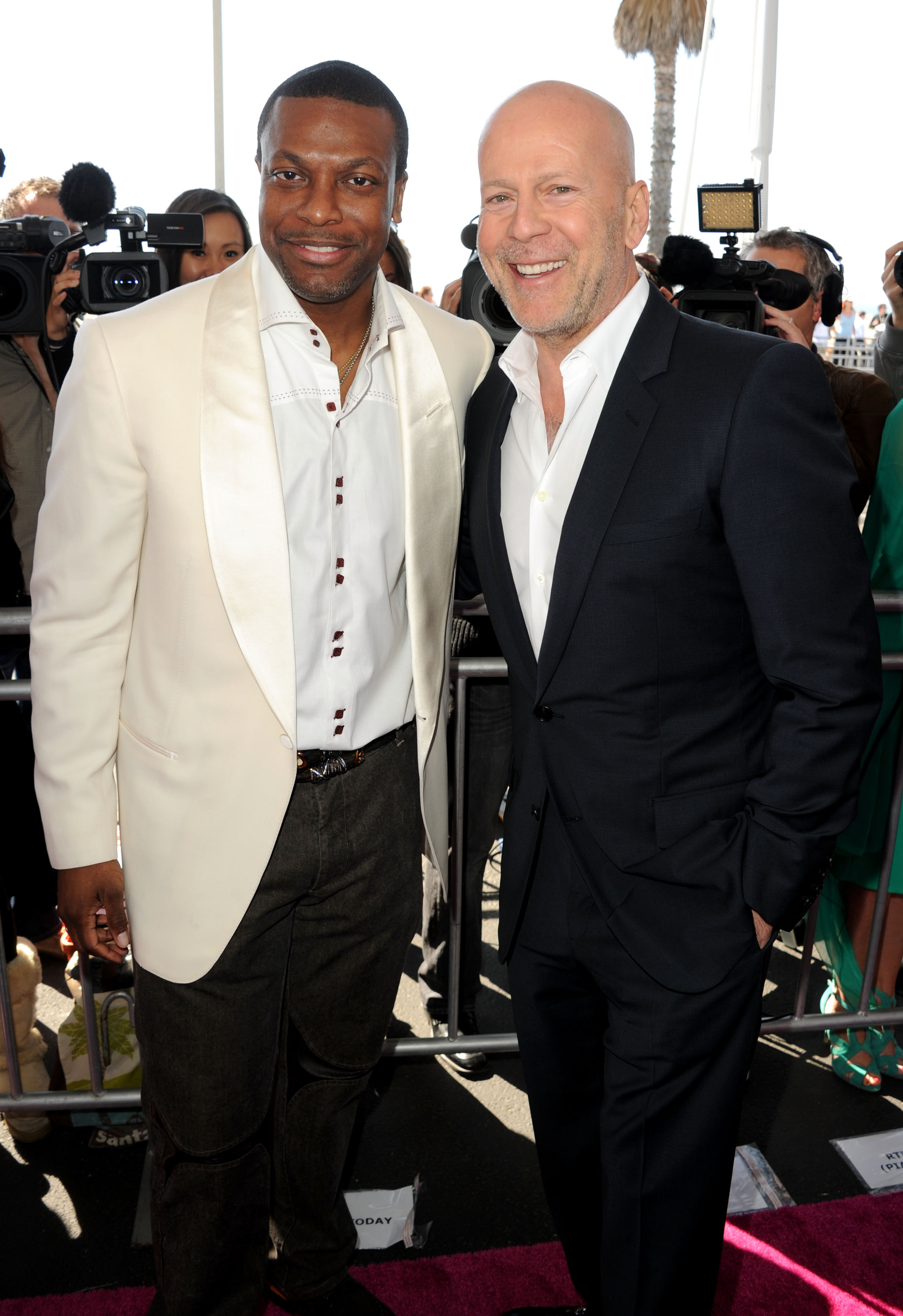 Chris Tucker and Bruce Willis on the red carpet at the Spirit Awards 2013.