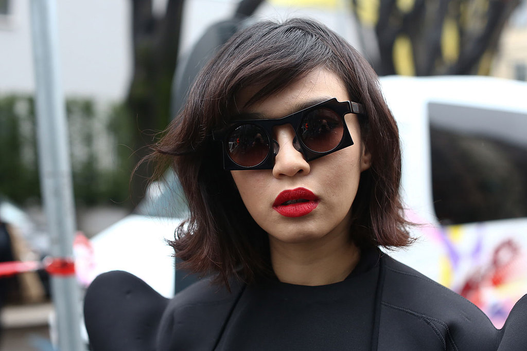 A classic red lip and a funky lob grounded this abstract eyewear look.