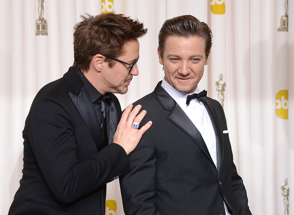 Robert Downey Jr. and Jeremy Renner shared a candid moment in the 2013 Academy Awards press room.