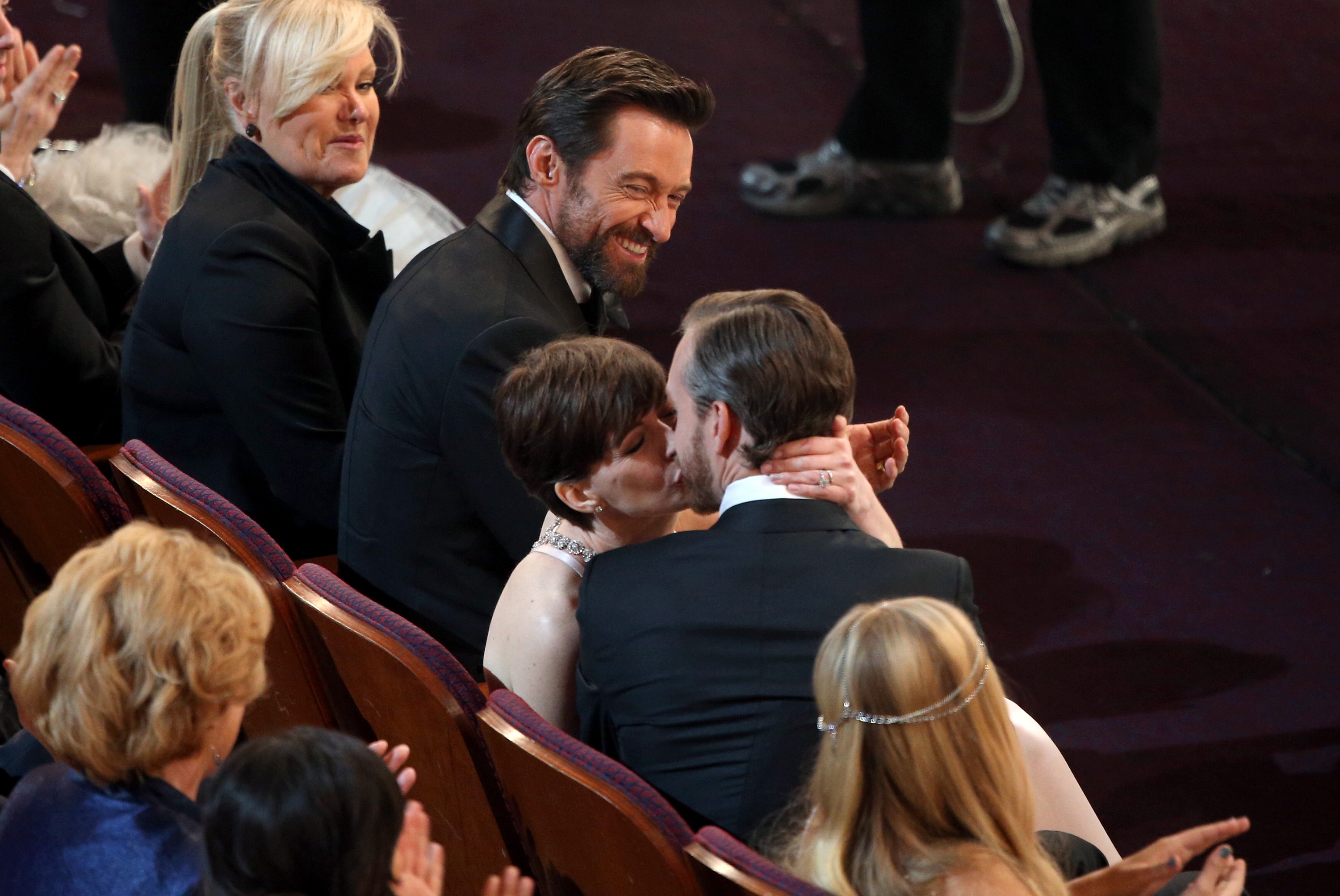 Anne Hathaway kissed her husband, Adam Shulman, while Hugh Jackman and his wife, Deborra-Lee Furness, looked on after her best supporting actress win was announced.